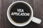 Word writing text Visa Application. Business concept for Form to ask permission travel or live in another country Black coffee with coffee mug floating texts on gray black wooden desk. poster