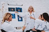 Doctor Speak with Young Student. Stethoscope and Nurse. Profession Doctor Medicine and Oncology. Consultation with Doctor. Profession Pharmacy Study. Therapy for Student. Work and Uniform for Student. poster
