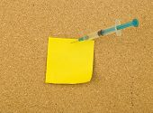 Cork bulletin board with note and syringe . poster