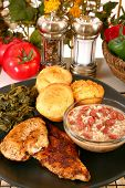 Cajun flavored catfish and chicken with red beans, turnip greens and jalepeno cornbread. poster