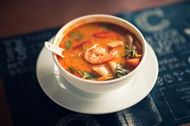 Tom Yum Goong Thai Hot Spicy Soup On Wooden Table,thai Popular Food Menu