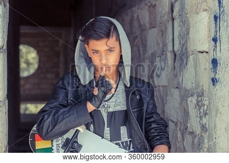 Teenager Boy Wide Eyed Asking For Silence Or Secrecy With Finger On Lips Hush Hand Gesture On Grunge