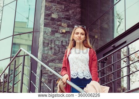 Business Woman Girl Student Descends On Stairs, Well Disposed Outside Business Office Building Schoo