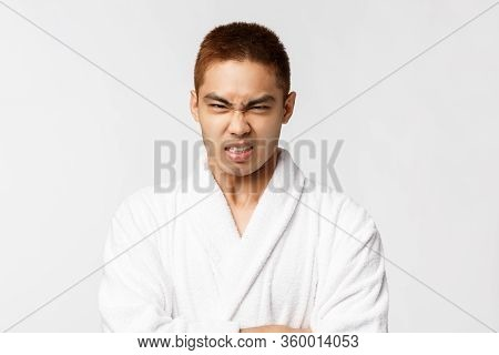 Beauty, Spa And Leisure Concept. Portrait Of Grumpy, Hateful Asian Man Look With Disdain And Hate, G