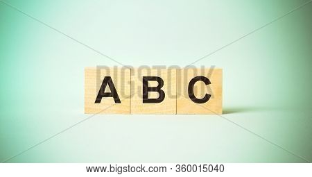 Abc Inscription In Letters On Wooden Blocks Isolated On Blue Background Learn Spelling Concept