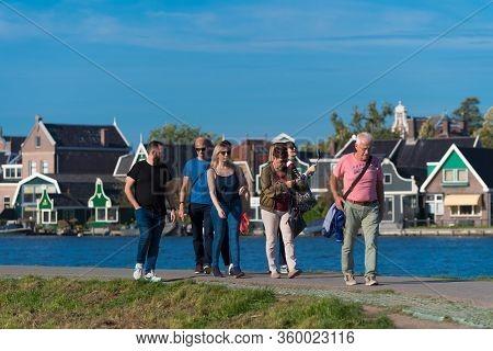 Zaanse Schans, Netherlands - October 13, 2018: Tourists In The Zaanse Schans, A Neighborhood With Hi