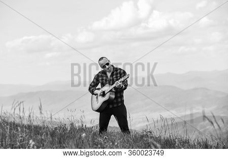 Hiker Enjoy Nature. Musician Hiker Find Inspiration In Mountains. Music For Soul. Playing Music. Sou