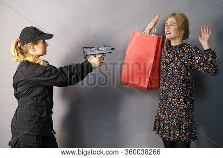 Shoplifting Is A Crime. Young Fashionable Woman Being Caught On Stealing Clothes By Female Security