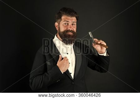 Retro Hipster. Hipster Hold Straight Razor. Brutal Hipster Wear Beard And Mustache. Bearded Man In C