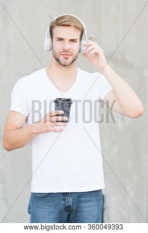 Enjoy Takeaway. Handsome Man Hold Hot Cup Outdoors. Young Guy Enjoy Beverage Listening To Music. Mor