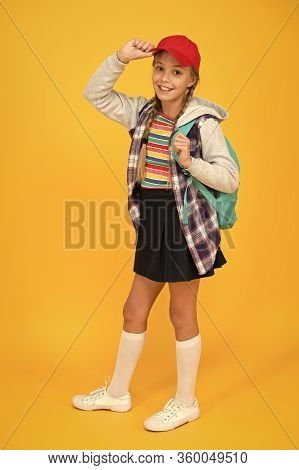 Happy Childhood. Cute Hipster Teenager Kid Yellow Background. Cheerful Teenager. Small Child Girl Lo