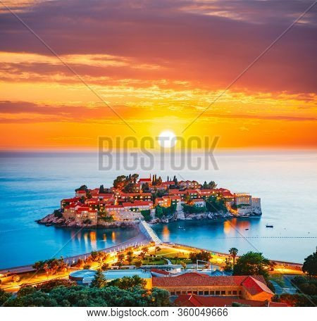 Gorgeous sundown over the small islet Sveti Stefan. Location place Montenegro, Adriatic sea, Europe. Image of most popular european travel destination. Summer vacation. Discover the beauty of earth.