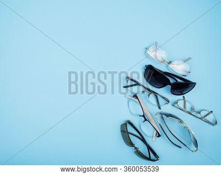 Glasses And Sunglasses On Blue Background. Corner Location. The View From The Top. The Concept Of St