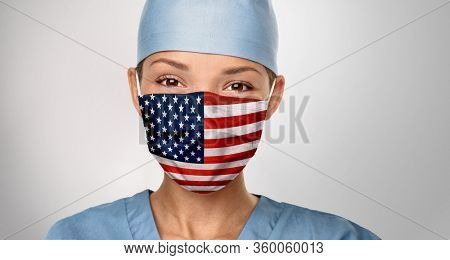 USA American doctor wearing Coronavirus pandemic COVID-19 mask in the United States of America. American flag print on Asian woman doctor's mask smiling in confidence giving hope .
