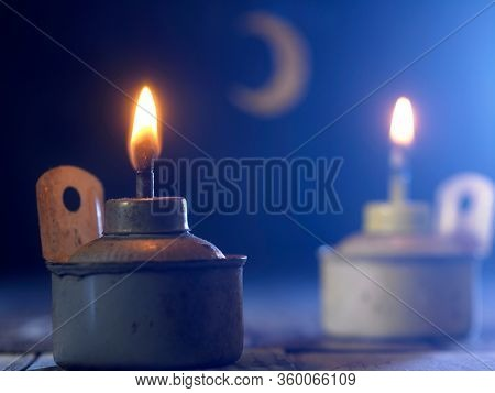 oil lamp with crescent on the blue background