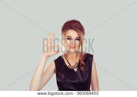 Everything Will Be Alright. Beautiful Young Happy Woman Showing Ok Sign Isolated On Light Gray Wall