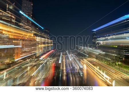 Melbourne Australia - March 9 2020; City At Night, Buildings, Lights And Reflections In Zoom Blur Ab