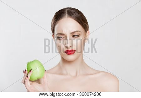 I Am Sick Of This Diet! Displeased Young Girl Looking With Disgust Disliking Apple Isolated White Ba
