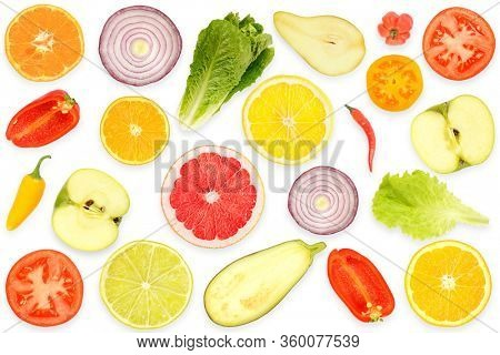 Top view of pattern fresh cut vegetables and fruits isolated on white background.