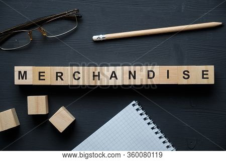 Modern Business Buzzword - Merchandise. Top View On Wooden Table With Blocks. Top View. Close Up.