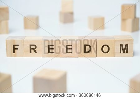 Modern Business Buzzword - Freedom. Word On Wooden Blocks On A White Background. Close Up.