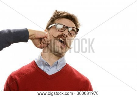 Portait of funny guy being punched on his face isolated on a white background