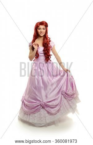 Young beautiful woman wearing a princess gown isolated on a white background