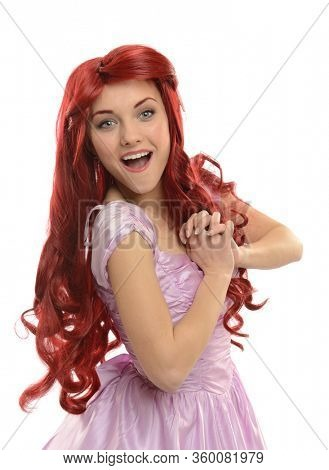 Young beautiful princess with red hair wearing a gown isolated on a white background