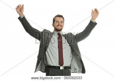 Young businessman celebrating with wide open arms isolated on a white background