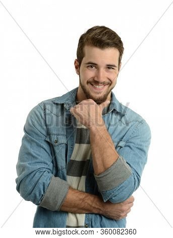 Young man cassually dressed smiling with hand on his chin isolated on a white background