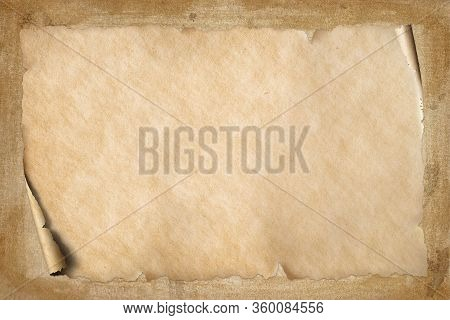Old Vintage Beige Paper With Corner Roll Up On Grungy Brown Textured Background