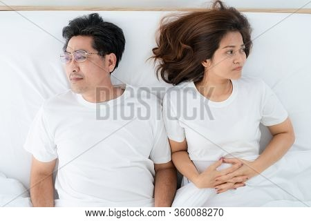 Unhappy Asian Senior Couple Feel Bad In Bedroom.