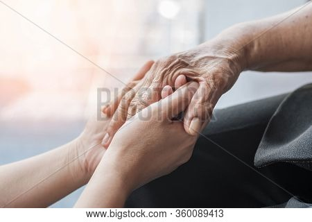 Parkinson Disease Patient, Alzheimer Elderly Senior, Arthritis Person Hand In Support Of Nursing Fam