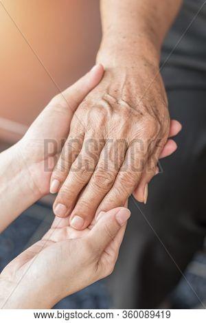 Parkinson Disease Patient, Alzheimer Elderly Senior, Arthritis Person's Hand In Support Of Nursing F