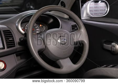 Novosibirsk, Russia - April 02, 2020  Nissan March, Auto Interior: Steering Wheel With Red Logo  Nis