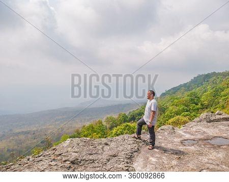 Asian Fat Trekker On Yeabmek Cliff Phu Kradueng Mountain National Park In Loei City Thailand.phu Kra