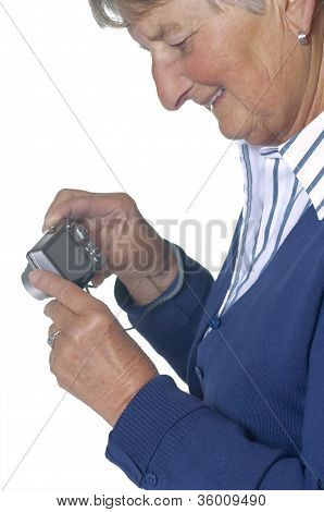 Pensioner With Modern Camera
