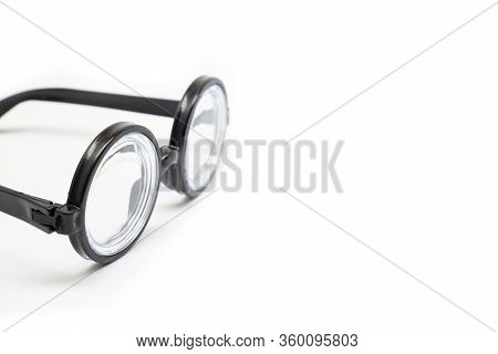 Isolate On White Background. Round Black Rimmed Glasses With Thick Lenses. Of Poor Vision. Funny.