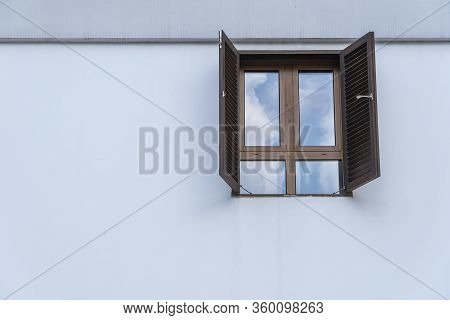 Window With Wooden Shutters On White Stucco Wall And Copy Space