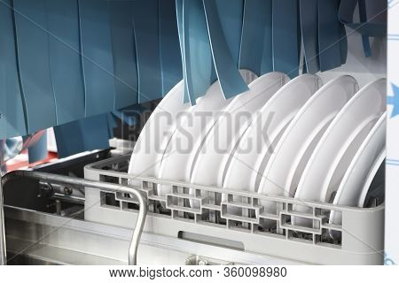The Automatic Dishwasher With White Clean Dishes In Basket .for Restaurant. Business Industrial Back