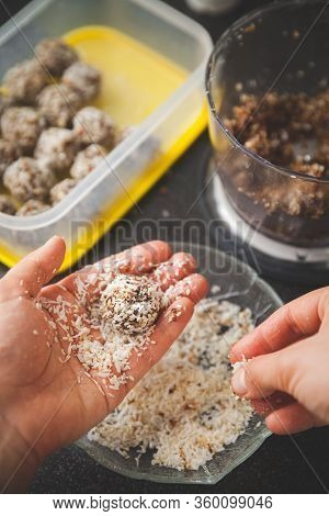 The Girl Is Preparing Sweet Treats. Protein Chocolate Balls. Healthy Sweets. Organic Raw Treats From