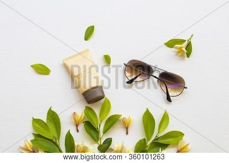 Sunscreen Spf50  Cosmetics Health Care For Skin Face, Sunglasses And Yellow Flowers Frangipani Of Li