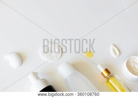 Beauty Products For Facial Skin Care On White Background, Above. Cleanser Foam, Tonic And Cotton Pad