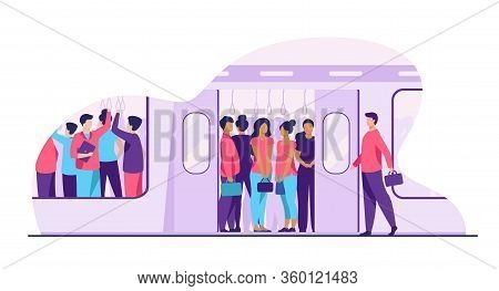 Crowd Of Commuters Traveling By Subway Train. Metro Passengers Standing In Overcrowding Tube Carriag