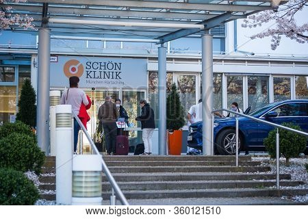 Munich,germany-apri 6,2020: Incoming Patients Talk To A Hospital Employee Wearing A Facemask Before