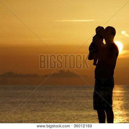 Father and child at sunset
