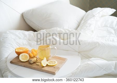 Cup With Antipyretic Drugs For Colds,flu.tea With Citrus Vitamin C,ginger Root,lemon,orange.wooden T