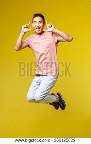 Summer Vacation, Education And Lifestyle Concept. Happy Enthusiastic, Handsome Asian Man Having Fun,