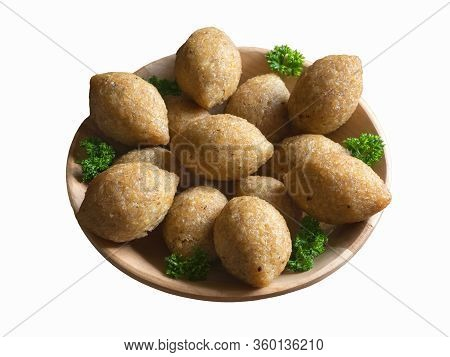 Isolated Arabic Meat Appetizer Kibbeh. Traditional Arabic Kibbeh With Lamb And Pine Nuts.