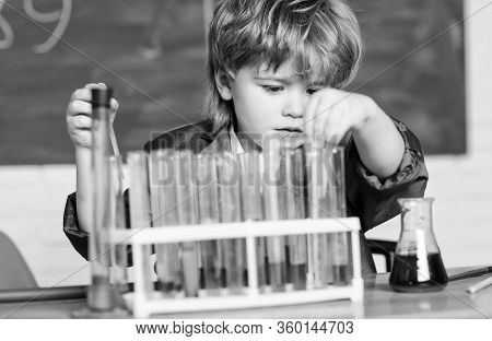 Science Concept. Wunderkind Experimenting With Chemistry. Boy Test Tubes Colorful Liquids Chemistry